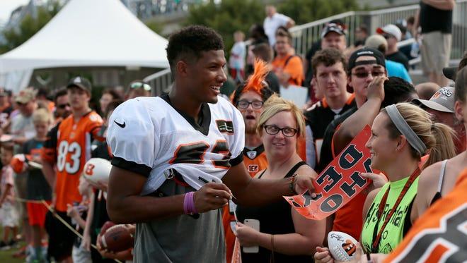 Cincinnati Bengals wide receiver Tyler Boyd (83) signs autographs after practice on Day 11 of training camp at the Paul Brown Stadium practice facility in downtown Cincinnati on Monday, Aug. 8, 2016. The Bengals continue training camp ahead of the Minnesota Vikings arrival for joint practice week and preseason play on Friday.