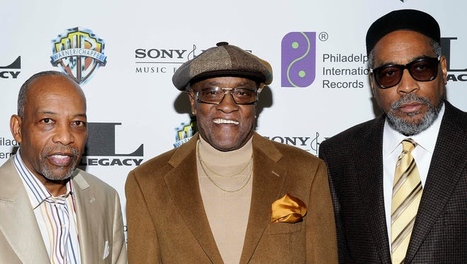 In this Feb. 6, 2008, file photo, Leon A. Huff, cofounder and vice chairman of Philadelphia International Records (from left), singer Billy Paul and Kenneth Gamble arrive at 'A Special Evening of Conversation Insight and Music' in Los Angeles.