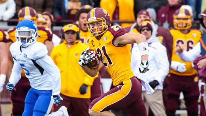 Algoma native Jesse Kroll (No. 21)  was named to the preseason watch list for the Fred Biletnikoff Award. The Central Michigan University senior receiver is shown making one of his seven receptions during a victory against Buffalo on Oct. 17, 2015.