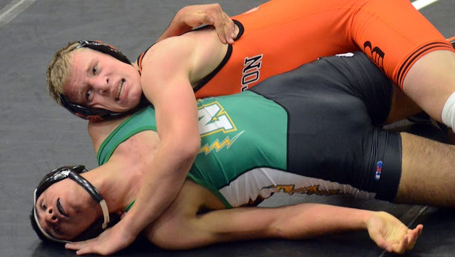 Greyson Stevens (top) was one of four Brighton wrestlers who went unbeaten in the Warren Woods-Tower Duals.
