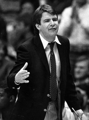 In this file photo of former head coach Tim Floyd taken in (2/28/1992) a younger version of the head coach that announced his sudden retirement Monday night, Nov.27, after a difficult loss to Lamar University.