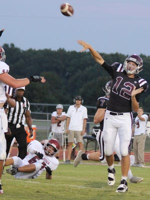 Eagleville QB Ethan Cobb fires a pass over a Cornersville defender Friday. Cobb passed for two TDs and rushed for another in a 31-6 win.