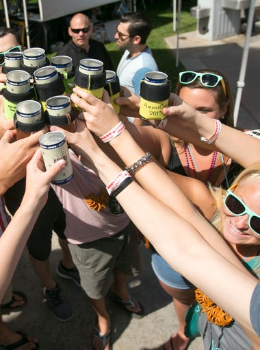Friends make a toast with their beer cans during the AmeriCAN Canned Craft Beer Festival at Scottsdale Civic Center on Saturday, May 16, 2015 Now in its fifth year, San Tan Brewing Co. hosted the AmeriCAN Canned Craft Beer Festival, which featured more 250 craft brews from around the world, all from recyclable cans.