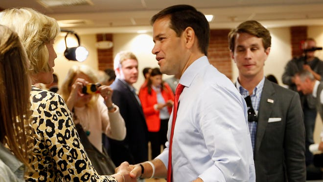 Republican presidential candidate, Sen. Marco Rubio, R-Fla., greets voters as he arrives for a town hall campaign stop in Dover, N.H.