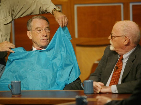In this 2004 file photo. U.S. Sen. Charles Grassey, left, and Democratic opponent Art Small prepare for a taping of Iowa Press at IPTV in Johnston. Grassley had just been given a last minute touch-up from the make-up artist.