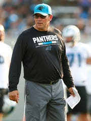 Carolina Panthers head coach Ron Rivera stands on the field during training camp at Wofford College.
