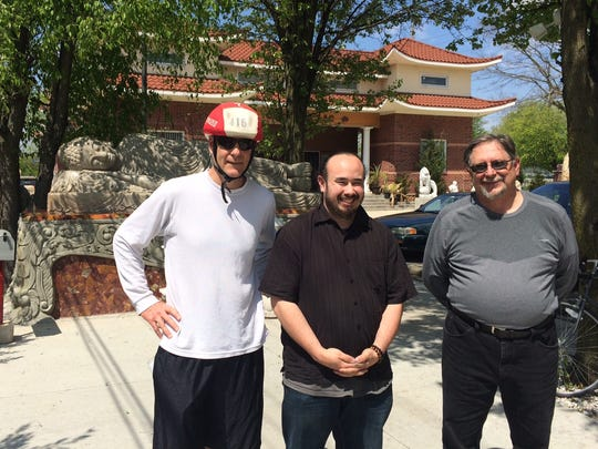 Trekkers Will Higgins (left) and Jim Lingenfelter (right) meet Viet Le at theAn Lac Buddhist Temple.