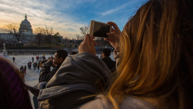 Students took photos of the sun setting behind Capitol Hill Thursday, February 19. About 100 high school and college students from Collier and Lee counties traveled to the Capitol to witness the presidential inauguration.