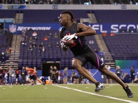 Clemson wide receiver Deon Cain runs a drill during the NFL football scouting combine, Saturday, March 3, 2018, in Indianapolis. (AP Photo/Darron Cummings)
