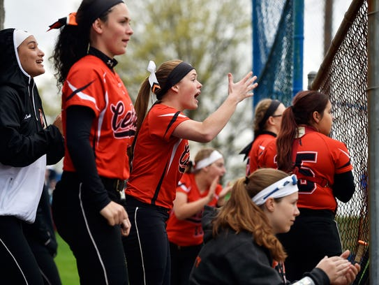 Central York's Erin Cabry, center, cheers as teammate