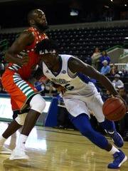 A&M-Corpus Christi's Rashawn Thomas drives to the basket against UTRGV's Dan Kimasa (23) during a non-conference men's basketball game at the American Bank Center on Tuesday, Nov. 29, 2016.