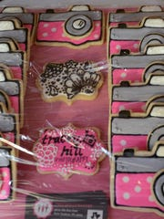 Tracey Hill had appropriately camera-like cookies made for her studio opening in South Lyon.