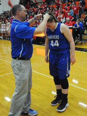 Southeastern Athletic Director Rick Strausbaugh awards Skylar Hice with a district runner-up medallion on March 3, 2017. Strausbaugh is now SE's boys basketball coach, as well as the scool's AD.
