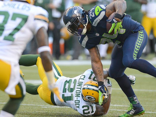 Packers safety Ha Ha Clinton-Dix (21) tries to tackle Marshawn Lynch (24) against the Seattle Seahawks at CenturyLink Field.