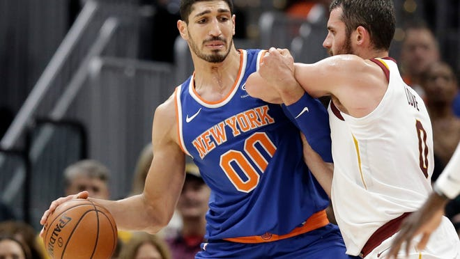 New York Knicks' Enes Kanter, left, drives past Cleveland Cavaliers' Kevin Love in the first half of an NBA basketball game, Sunday, Oct. 29, 2017, in Cleveland. (AP Photo/Tony Dejak)
