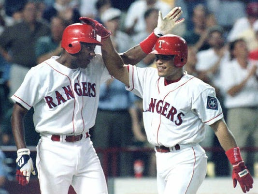 "Ivan""Pudge""Rodriguez of the Texas Rangers (R) is c"