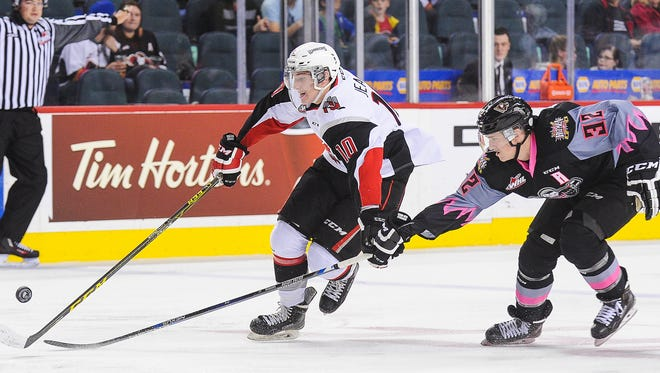 Defenseman Travis Sanheim, right, may be out of action for a bit with an upper-body injury.