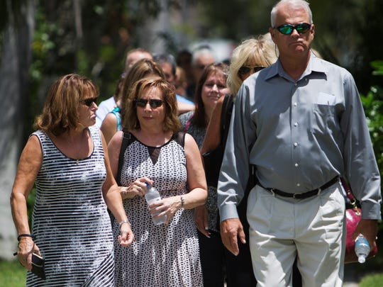 """Mourners walk toward First United Methodist Church before the funeral of Mary Knowlton.  Knowlton was killed last Tuesday by a Punta Gorda Police officer in an accidental shooting during a """"shoot or don't shoot"""" scenario at the Punta Gorda Safety Complex."""