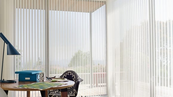 Vertical blinds let the light in when you want it,