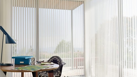 Vertical blinds let the light in when you want it, keep it out when you don't.