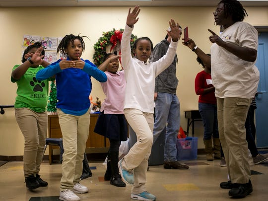 Denita Brown leads a group of her dancers at Preston Taylor Ministries Friday, Dec. 15, 2017 in Nashville, Tenn. Brown, in addition to the 25 hours a week she works for Preston Taylor Ministries, also spends another 30 hours volunteering, taking girls to field trips, plays, shows, and sleepovers.