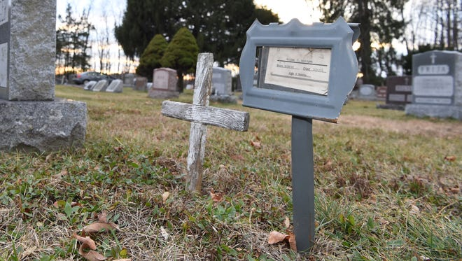 A small placard at LaGrange Rural Cemetery marks the final resting place of Elijah Williams, a six-month-old infant who died of sudden infant death syndrome in Highland in 2011.