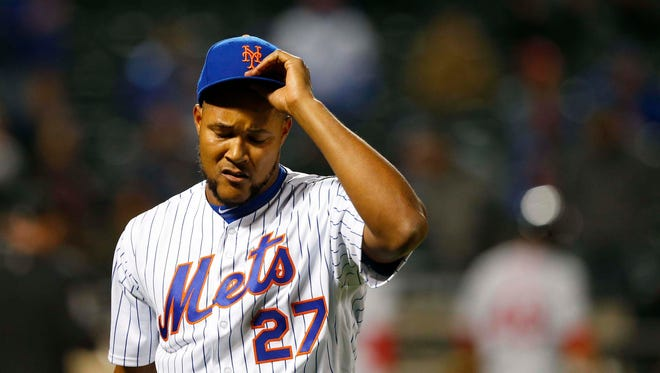 New York Mets relief pitcher Jeurys Familia (27) reacts after giving up runs to the Washington Nationals in the eighth inning at Citi Field.