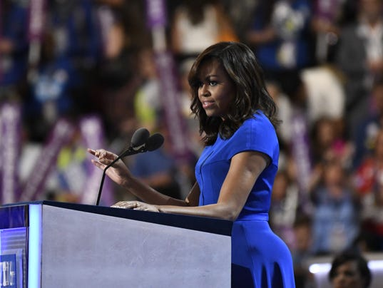 First lady Michelle Obama takes the stage during the Democratic ...
