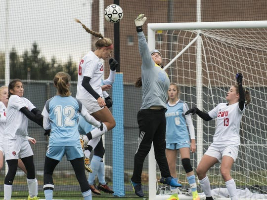 South Burlington goalie Bailey Burt (0) leaps to knock the ball away during the girls high school playoff game between the Champlain Valley Union Redhawks and the South Burlington Rebels at South Burlington High School on Saturday afternoon in South Burlington.