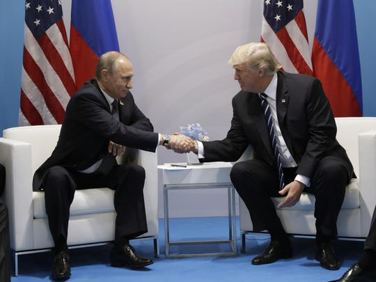 President Donald Trump shakes hands with Russian President Vladimir Putin at the G20 Summit, Friday in Hamburg.