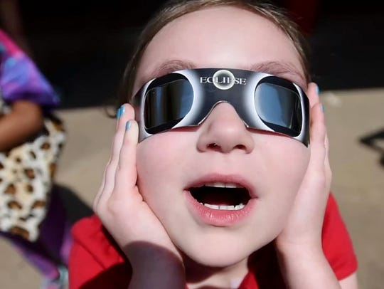 A University Elementary student views the eclipse Monday