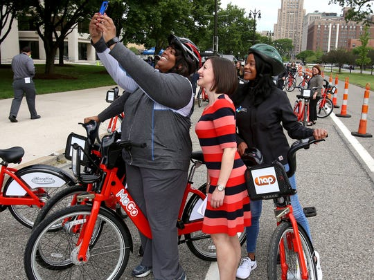 From left, Jennifer Bright of Downtown Detroit Partnership takes a selfie of Lisa Nuszkowski, executive director of MoGo and Tasha Nickerson, Downtown Detroit Partnership before Bright and Nickerson were to ride the new MoGo bikes at  Henry Ford Health System's One Ford Place in Detroit on Tuesday, May 23, 2017.