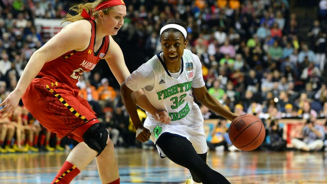 Notre Dame Fighting Irish guard Jewell Loyd (32) drives against Maryland Terrapins forward Tierney Pfirman (22)  during the second half in the semifinals of the Final Four in the 2014 NCAA Womens Division I Championship tournament at Bridgestone Arena.