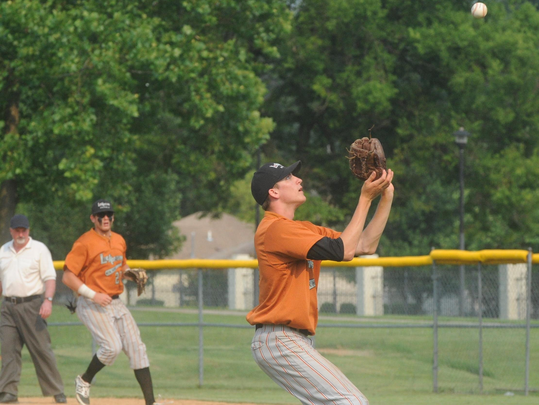 Mountain Home pitcher Ryan Czanstkowski, right, catches a pop-up during a recent game at Cooper Park.