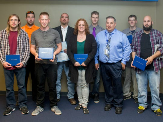 Graduating from Moraine Park Technical College's Computer Numerical Control (CNC) machinist boot camp on June 9 were (front row, left to right) Robert Knapp, Zachary Coyle, Laura Peter, Instructor James Gyorfy, Daniel Nielson; (back row) Lester Zielicke, Kevin Anderson, Tanner Hass and Jesse Farber.