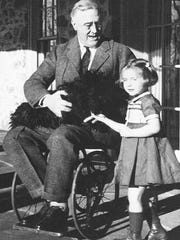 President Franklin Roosevelt comforts a girl recovering from polio.