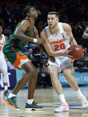 Syracuse forward Tyler Lydon, a Pine Plains product, drives against Miami's Anthony Lawrence Jr. in Brooklyn on March 8.
