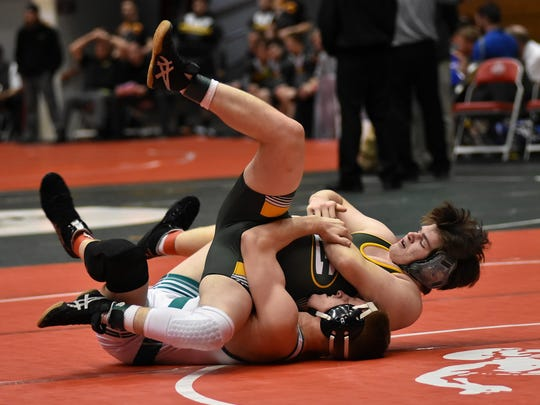 Eric Vermillion of Mason (bottom) rolls his Lakewood St. Edward 170lb opponent over for points leading to a Comets decision in the Division1 OHSAA State Duals Quatrerfinals in Columbus, Ohio, February11, 2018.