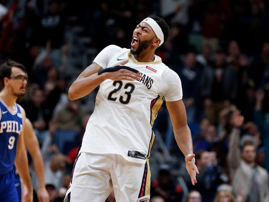 New Orleans Pelicans forward Anthony Davis (23) celebrates his three-point basket in the second half of an NBA basketball game against the Philadelphia 76ers in New Orleans, Sunday, Dec. 10, 2017. (AP Photo/Gerald Herbert)