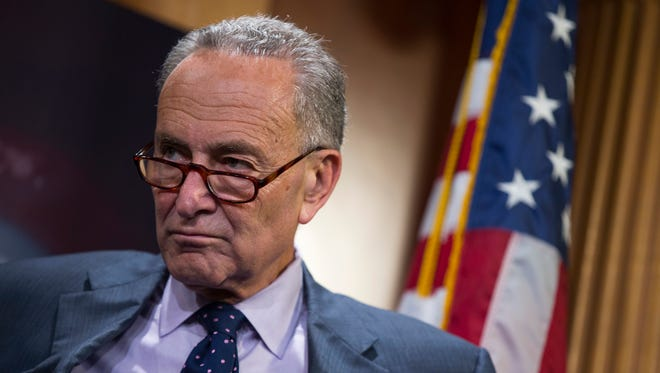 Sen. Charles Schumer, D-N.Y. listens during a news conference Thursday, Oct. 1, 2015, on Capitol Hill in Washington.