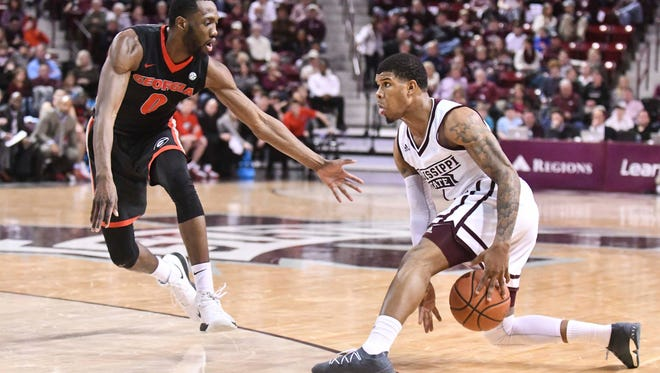 Mississippi State Bulldogs guard Lamar Peters (1) handles the ball as he is defended by Georgia Bulldogs guard William Jackson II.