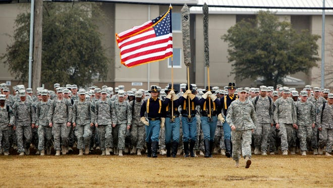 U.S. Army 1st Cavalry 3rd Brigade soldiers march onto the parade grounds at Fort Hood, Texas, upon their return home in 2011 from deployment in Iraq. Troops returning from combat use prescription narcotics at a much higher rate than that of civilians, researchers say.