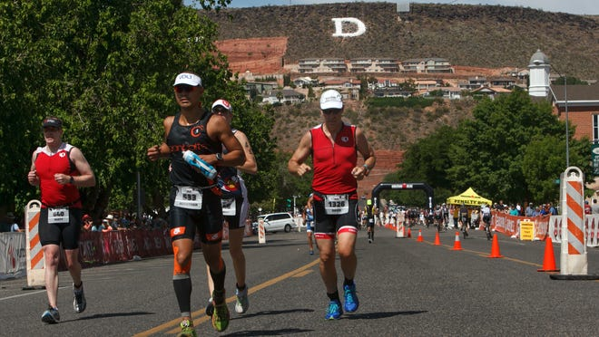 Ironman St. George 70.3 competitors start out on the running leg of the Ironman race in downtown St. George Saturday, May 2, 2015.