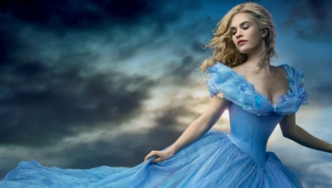"Lily James plays Ella in Disney's newest version of ""Cinderella,"" now in theaters."