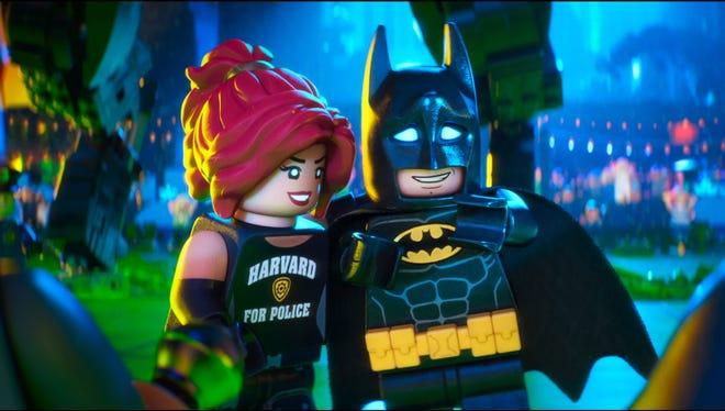 Batman (right, voiced by Will Arnett) is a little shy around Barbara Gordon (Rosario Dawson) in 'The Lego Batman Movie.'