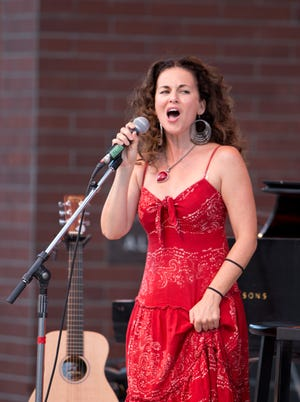 Sherrie Austin performs at the opening night of Artown at Wingfield Park in downtown Reno, on Tuesday, July 1, 2014.