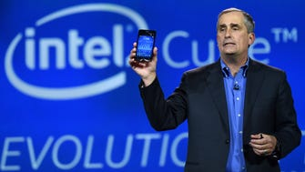 Intel CEO Brian Krzanich shows how many steps he took during a keynote address as tracked by a wearable processor called Curie, a prototype open source computer the size of a button that he unveiled at the 2015 International CES at The Venetian Las Vegas on Jan. 6, 2015, in Las Vegas.