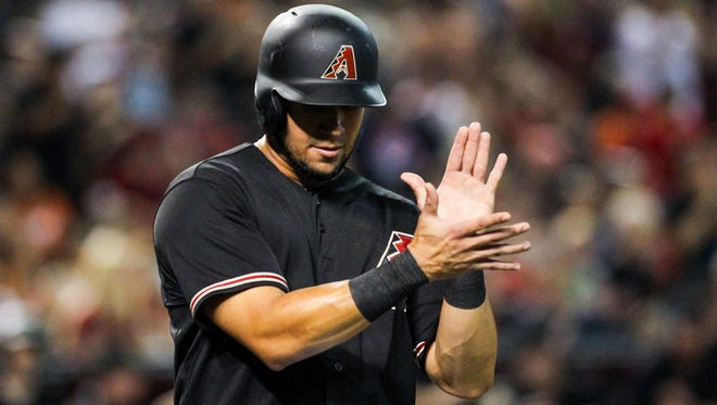 Arizona Diamondbacks hitter David Peralta scores a run against the San Francisco Giants in the second inning at Chase Field in Phoenix, on Saturday, July 18, 2015.