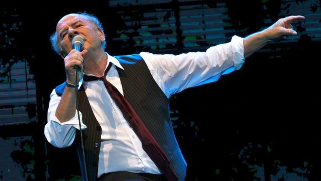Grammy Award-winning American singer Art Garfunkel performs on stage at the Bloomfield Stadium in the Israeli city of Tel Aviv, on June 10, 2015.