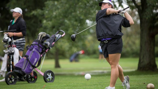 Olivia Phillips, a golfer with Central, competes in sectionals Saturday afternoon at the Crestview Golf Club in Muncie.
